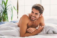 Радостный парень ослабляя дома Стоковые Фотографии RF
