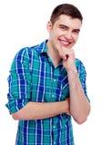 Радостный парень с рукой на подбородке Стоковые Фотографии RF