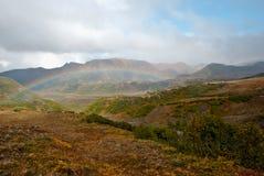 Радуга над холмами Стоковое фото RF