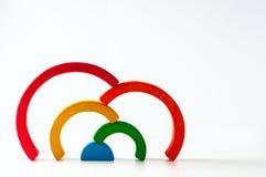 Радуга, пестротканая деревянная игрушка eco Изолировано на белизне Стоковые Изображения