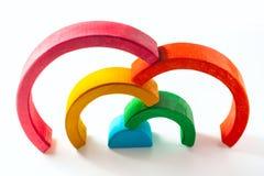 Радуга, пестротканая деревянная игрушка eco Изолировано на белизне Стоковые Фото