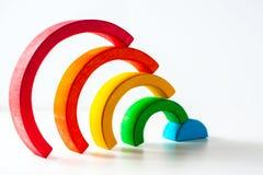 Радуга, пестротканая деревянная игрушка eco Изолировано на белизне Стоковые Фотографии RF