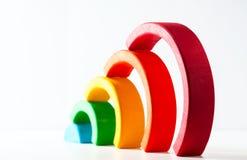 Радуга, пестротканая деревянная игрушка eco На белизне Стоковое Фото