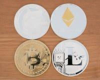 Реальные монетки ryptocurrency Bitcoin Ethereum Dogecoin и Litecoin стоковое изображение