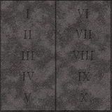 Реалистические 10 правил заповедей бога writed на таблетке камней Стоковые Фотографии RF