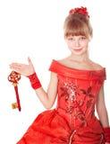 ребенка рождества платья удерживания ключа красный цвет длиной Стоковая Фотография RF