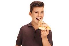 Ребенк есть кусок пиццы Стоковые Фотографии RF