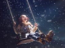 Ребенк на темной предпосылке стоковое изображение