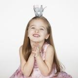 Ребенк принцессы держа руки совместно умоляя Стоковые Фотографии RF