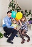 Ребенк при родители празднуя день рождения Стоковые Фотографии RF