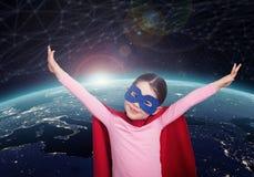 Ребенк супергероя против земли элементы перевода 3D этого изображения поставленные NASA стоковые изображения