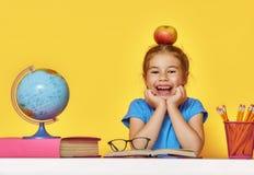Ребенк учит в классе Стоковое Изображение