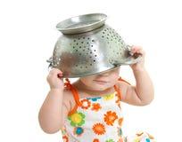 ребенок варя над белизной Стоковое фото RF
