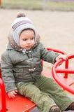 Ребенок в карусели Стоковое Изображение