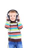 Ребенок в наушниках, белая предпосылка Стоковая Фотография