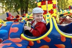 Ребенок в плоскости на carousel стоковые фото