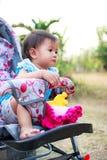 Ребенок в прогулочной коляске Стоковое Изображение RF