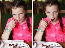 Ребенок девушки есть торт в кафе Стоковые Изображения