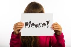 Ребенок держа пожалуйста подписывает Стоковые Изображения RF