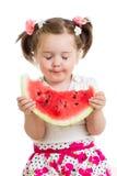 Ребенок есть изолированный арбуз Стоковое Изображение