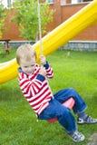 Ребенок ехать качание Стоковые Изображения RF