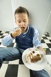 ребенок жадный стоковая фотография