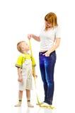 Ребенок женщины измеряя стоковая фотография rf