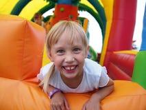 Ребенок играя в надувном замке Стоковая Фотография RF