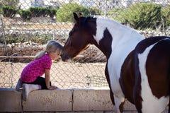 Ребенок и лошадь Стоковая Фотография
