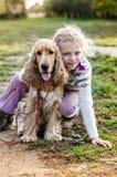 Ребенок и собака стоковые изображения