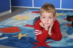 ребенок ковра Стоковое Изображение