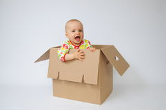 ребенок коробки Стоковое фото RF