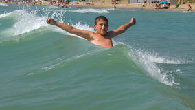 Ребенок купая в море Стоковые Фото