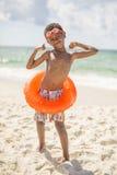 Ребенок на пляже в купальнике Стоковые Изображения RF