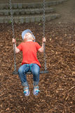 Ребенок на спортивной площадке Стоковое Изображение RF