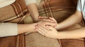 Ребенок нежно обнял мои руки ` s матери Полное видео HD сток-видео