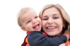 ребенок обнимает мать Стоковое Фото