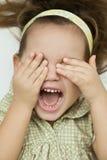 Ребенок покрывает его сторону с его руками Стоковое фото RF
