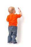 ребенок рисует красный цвет карандаша Стоковое фото RF