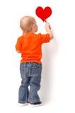 ребенок рисует красный цвет сердца Стоковые Фотографии RF