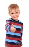 Сь ребенок с большими пальцами руки вверх по знаку, изолированному на белизне Стоковые Фотографии RF