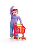 Ребенок с вагонеткой покупок игрушки Стоковые Фото