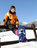 Ребенок с голубыми snowshoes Стоковое фото RF
