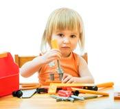Ребенок с инструментами игрушки Стоковое Изображение