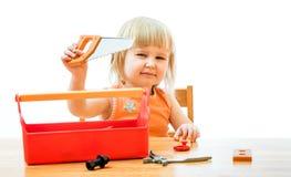 Ребенок с инструментами игрушки Стоковая Фотография