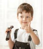 Ребенок с инструментом стоковая фотография rf