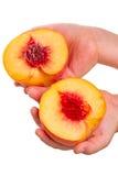 Ребенок с половинами персика на белизне Стоковые Изображения