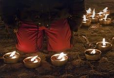 Ребенок с свечами на квадрате Стоковые Изображения