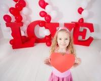 Ребенок с сердцем Стоковые Фотографии RF