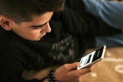 Ребенок с телефоном Стоковое Изображение